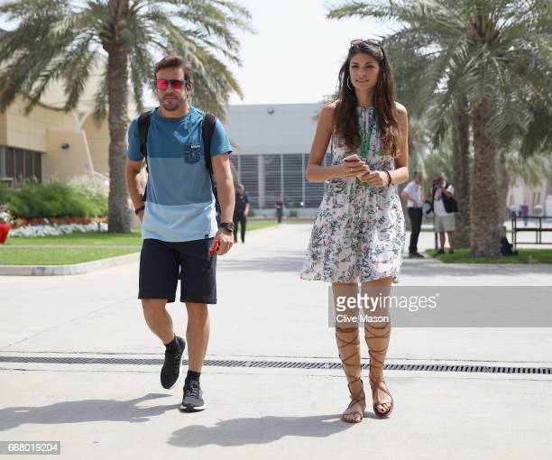 Fernando Alonso of Spain and McLaren Honda walks in the Paddock with girlfriend Linda Morselli during previews to the Bahrain Formula One Grand Prix...