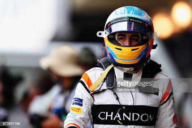 Fernando Alonso of Spain and McLaren Honda walks in the Pitlane during final practice for the Formula One Grand Prix of Brazil at Autodromo Jose...