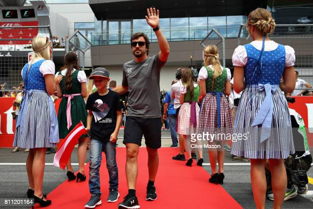 Fernando Alonso of Spain and McLaren Honda walks to the drivers parade before the Formula One Grand Prix of Austria at Red Bull Ring on July 9 2017...