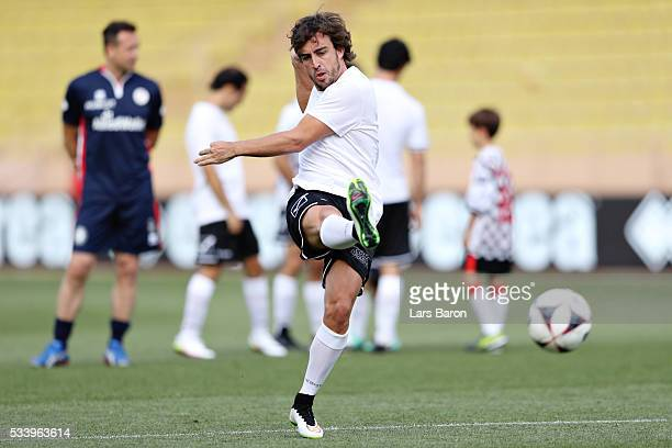 Fernando Alonso of Spain and McLaren Honda warms up on the pitch during the 24th World Stars football match at Stade Louis II Monaco before the...