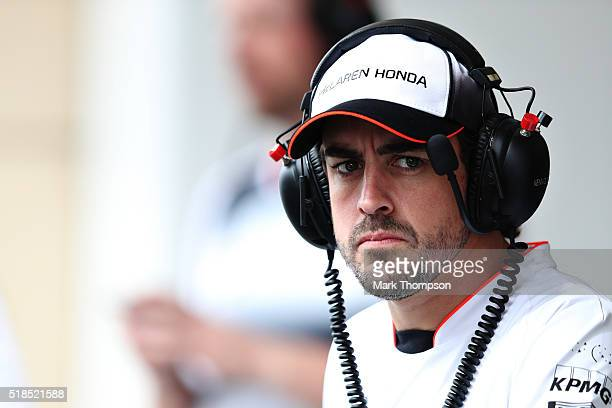 Fernando Alonso of Spain and McLaren Honda watches the action in the pitlane during practice for the Bahrain Formula One Grand Prix at Bahrain...