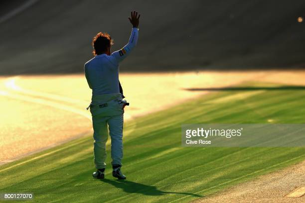 Fernando Alonso of Spain and McLaren Honda waves to the crowd after stopping on track during practice for the Azerbaijan Formula One Grand Prix at...