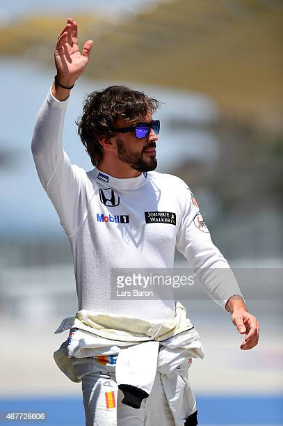 Fernando Alonso of Spain and McLaren Honda waves to the crowd during practice for the Malaysia Formula One Grand Prix at Sepang Circuit on March 27...