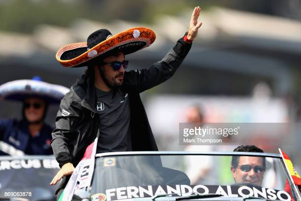 Fernando Alonso of Spain and McLaren Honda waves to the crowd on the drivers parade before the Formula One Grand Prix of Mexico at Autodromo Hermanos...