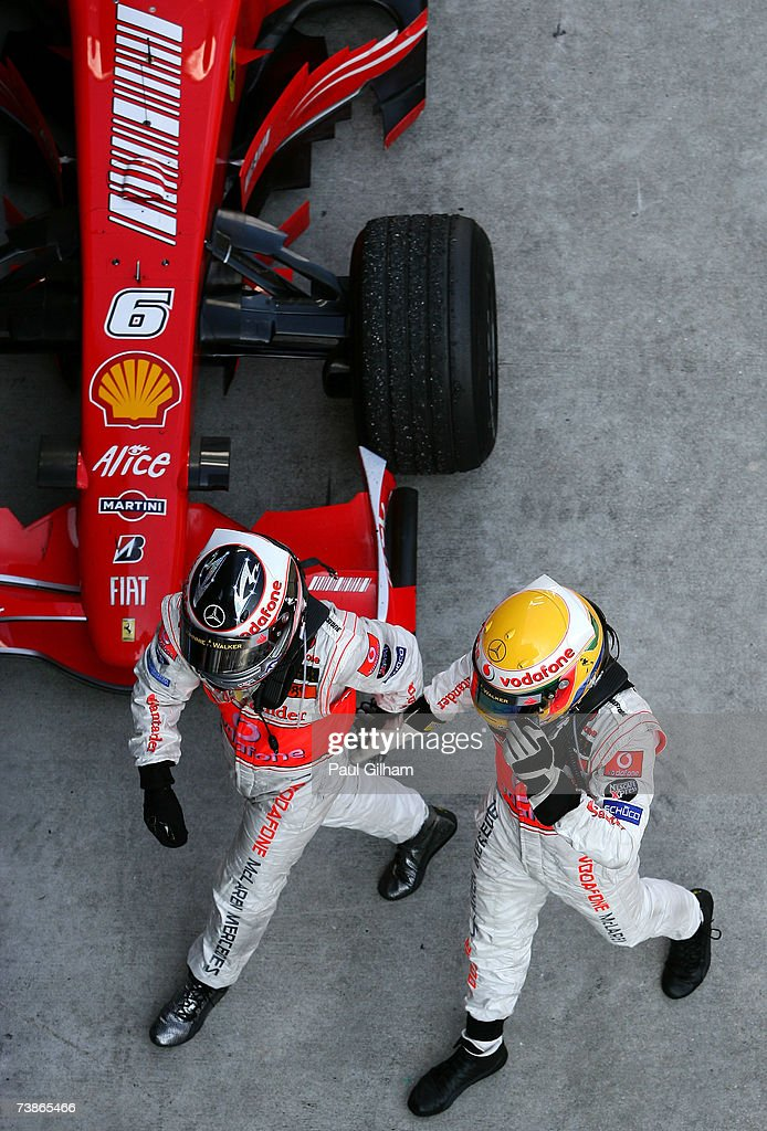 Fernando Alonso of Spain and McLaren Mercedes (L) and Lewis Hamilton of Great Britain and McLaren Mercedes (R) celebrate in Parc Ferme after finishing first and second in the Malaysian Formula One Grand Prix at the Sepang Circuit on April 8, 2007, in Kuala Lumpur, Malaysia.