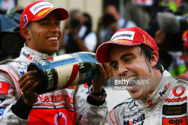Fernando Alonso of Spain and McLaren Mercedes celebrates with team mate Lewis Hamilton of Great Britain after winning the Monaco Formula One Grand...