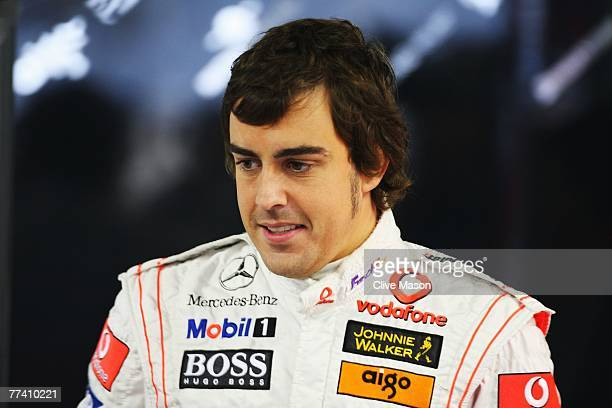 Fernando Alonso of Spain and McLaren Mercedes is seen in his team garage during practice for the Brazilian Formula One Grand Prix at the Autodromo...