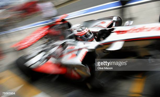 Fernando Alonso of Spain and McLaren Mercedes pulls into the pits during the previews to the German Grand Prix at Nurburgring on July 19, 2007 in...