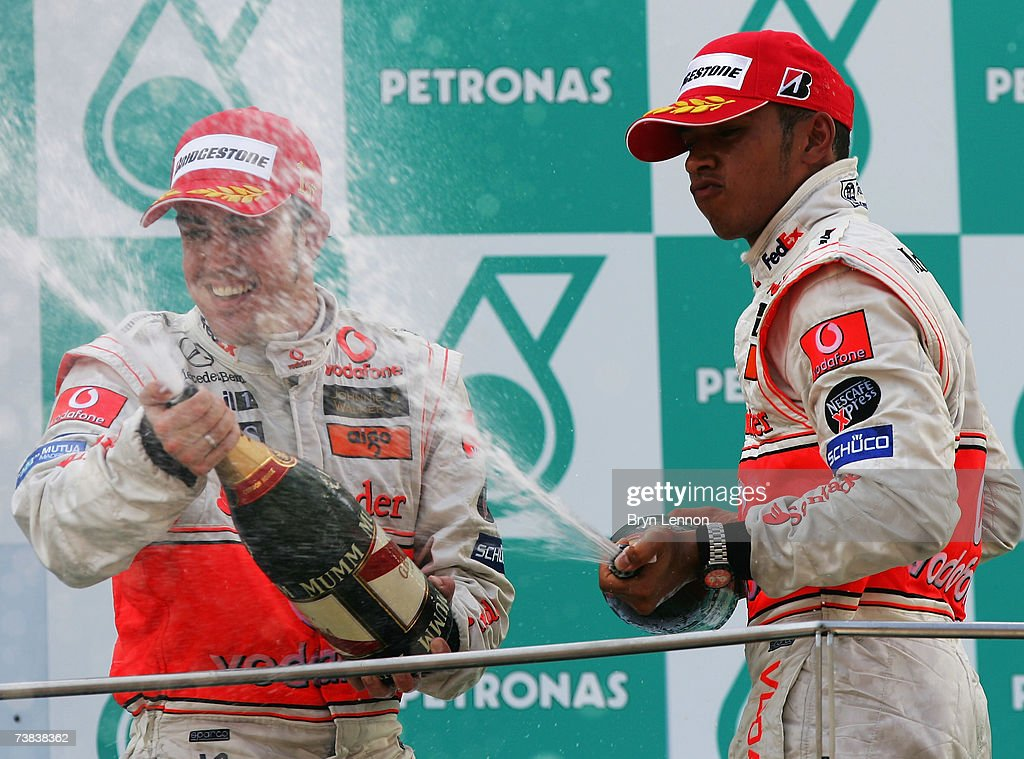 Fernando Alonso of Spain and McLaren Mercedes sprays champagne with team mate Lewis Hamilton of Great Britain after they finished first and second in the Malaysian Formula One Grand Prix at the Sepang Circuit on April 8, 2007, in Kuala Lumpur, Malaysia.