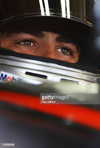 Fernando Alonso of Spain and McLaren Mercedes waits to drive in his car before practice for the Monaco Formula One Grand Prix at the Monte Carlo...