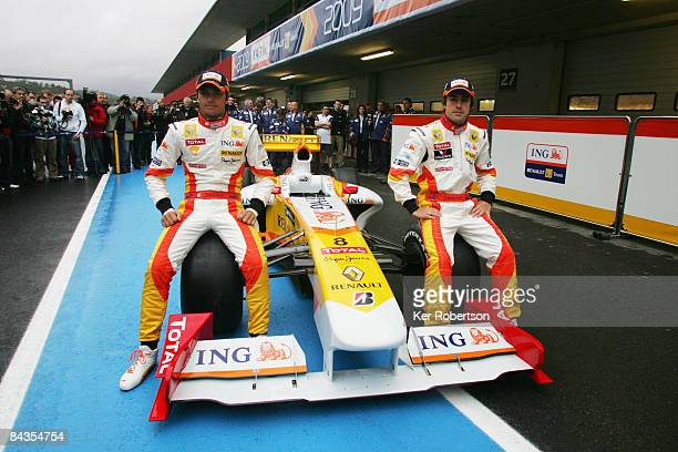 Fernando Alonso of Spain and Nelson Piquet of Brazil attend the unveiling of their new Renault R29 Formula One car at the Autodromo Internacional do...