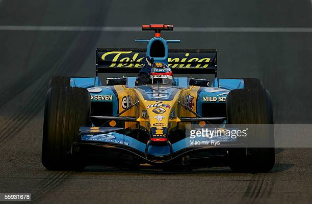 Fernando Alonso of Spain and Renault celebrates after winning the Chinese F1 Grand Prix at the Shanghai International Circuit on October 16, 2005 in...