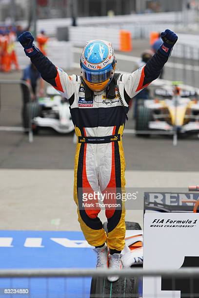 Fernando Alonso of Spain and Renault celebrates in parc ferme after winning the Japanese Formula One Grand Prix at the Fuji Speedway on October 12...