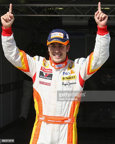 Fernando Alonso of Spain and Renault celebrates in parc ferme after taking pole position during qualifying for the Hungarian Formula One Grand Prix...