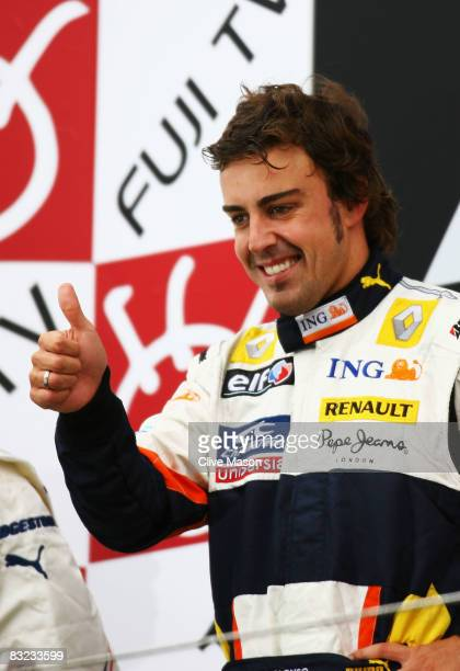 Fernando Alonso of Spain and Renault celebrates on the podium after winning the Japanese Formula One Grand Prix at the Fuji Speedway on October 12,...