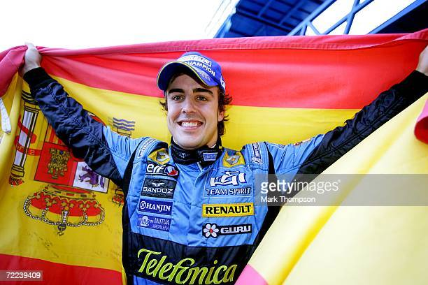 Fernando Alonso of Spain and Renault celebrates winning the Formula One Grand Prix World Championship after the Brazilian Formula One Grand Prix at...