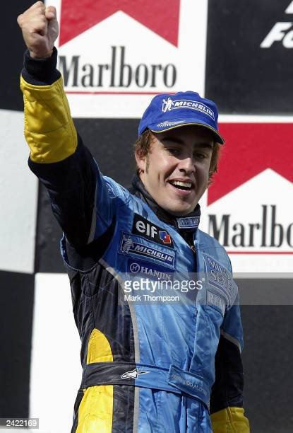 Fernando Alonso of Spain and Renault celebrates winning the the Formula One Hungarian Grand Prix at the Hungaroring on August 24 2003 in Budapest...