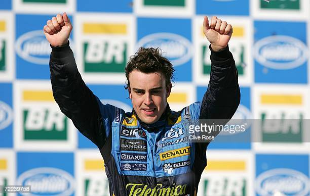 Fernando Alonso of Spain and Renault celebrates winning the World Championship after finishing second in the Brazilian Formula One Grand Prix at the...