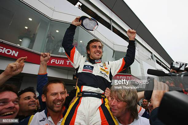 Fernando Alonso of Spain and Renault celebrates with his team mates after winning the Japanese Formula One Grand Prix at the Fuji Speedway on October...