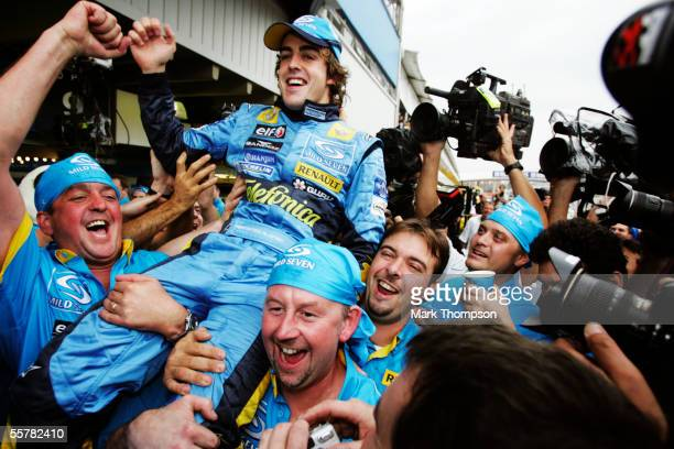 Fernando Alonso of Spain and Renault celebrates with his teammates after winning the World Championship after finishing third in the Brazilian F1...