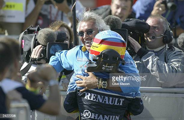 Fernando Alonso of Spain and Renault celebrates with Renault team Boss Flavio Briatore after winning the Formula One Hungarian Grand Prix at the...