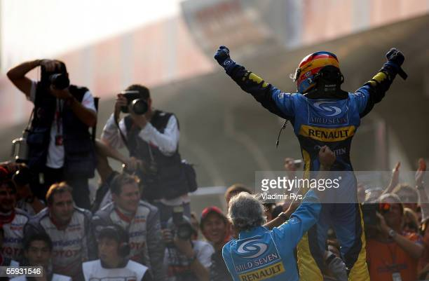Fernando Alonso of Spain and Renault celebrates with the team principal Flavio Briatore after winning the Chinese F1 Grand Prix at the Shanghai...
