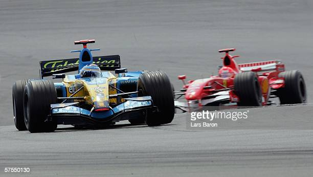 Fernando Alonso of Spain and Renault drives infront of Michael Schumacher of Germany and Ferrari during the F1 Grand prix of Europe at the...