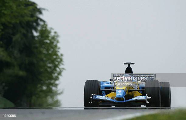 Fernando Alonso of Spain and Renault in action during practice for the Formula One San Marino Grand Prix on April 19 2003 at the Autodromo...
