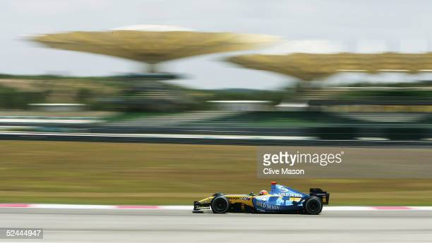 Fernando Alonso of Spain and Renault in action during practice for the Malaysian Formula One Grand Prix at Sepang Circuit on March 18 2005 in Kuala...