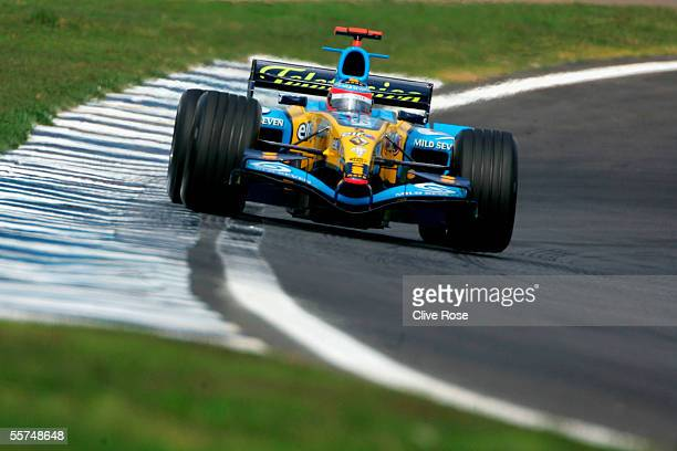 Fernando Alonso of Spain and Renault in action during practice for the Brazilian F1 Grand Prix at the Autodromo Interlagos on September 23, 2005 in...