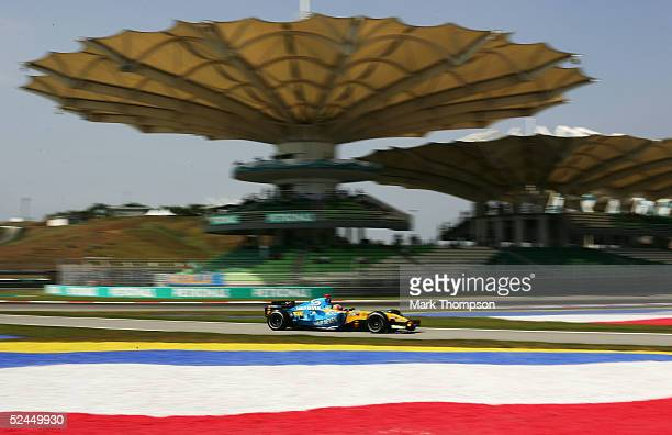 Fernando Alonso of Spain and Renault in action during practice prior to qualifying for the Malaysian Formula One Grand Prix at Sepang Circuit on...