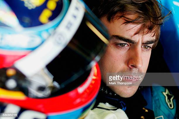 Fernando Alonso of Spain and Renault in the pits during the second practice session as he prepares for the United States F1 Grand Prix at the...