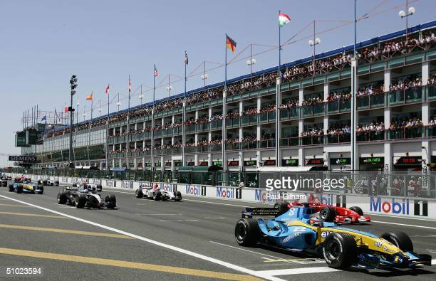 Fernando Alonso of Spain and Renault is first to get away off the grid at the start of the French F1 Grand Prix at the Magny-Cours Circuit, on July 4...