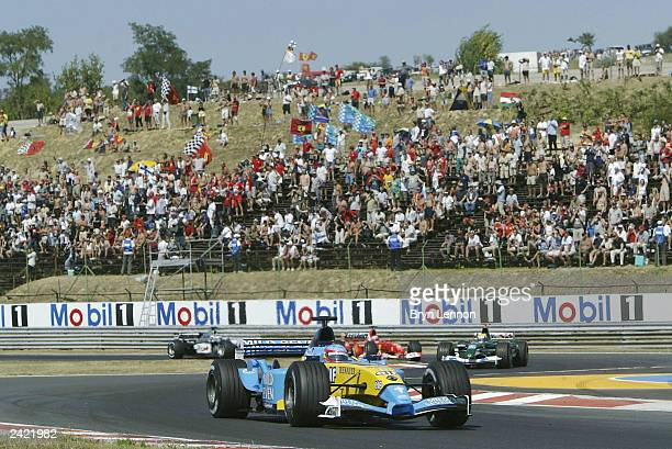 Fernando Alonso of Spain and Renault leads at the start of the Formula One Hungarian Grand Prix at the Hungaroring on August 24, 2003 in Budapest,...