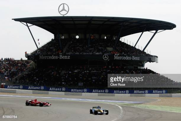 Fernando Alonso of Spain and Renault leads Michael Schumacher during the European F1 Grand Prix at the Nurburgring on May 7 in Nurburg, Germany.