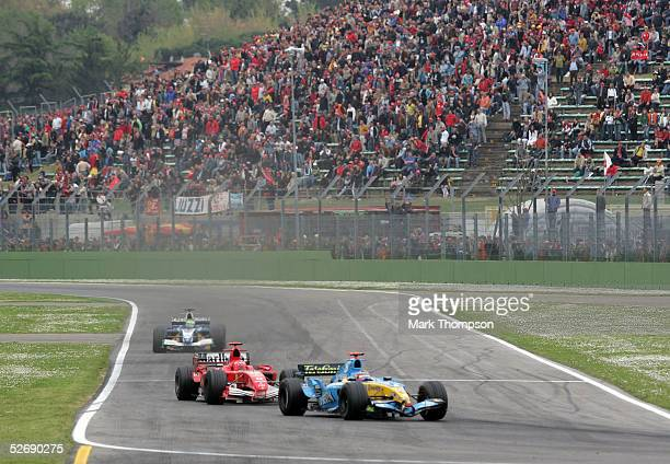 Fernando Alonso of Spain and Renault leads Michael Schumacher of Germany and Ferrari during the San Marino F1 Grand Prix at the San Marino Circuit on...