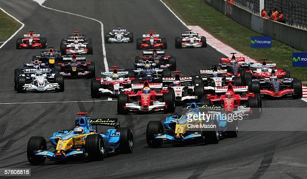 Fernando Alonso of Spain and Renault leads the pack in to the first corner during the Spanish Formula One Grand Prix at the Circuit De Catalunya on...