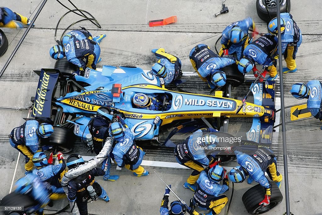 Fernando Alonso of Spain and Renault makes a pit stop during the Malaysian Formula One Grand Prix at the Sepang Circuit on March 19, 2006, in Kuala Lumpur, Malaysia.