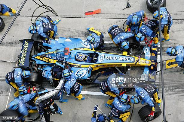 Fernando Alonso of Spain and Renault makes a pit stop during the Malaysian Formula One Grand Prix at the Sepang Circuit on March 19 in Kuala Lumpur...