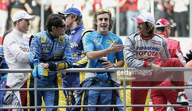 Fernando Alonso of Spain and Renault shares a joke with Jarno Trulli of Italy and Toyota during the drivers end of year photo session prior to the...