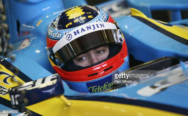 Fernando Alonso of Spain and Renault sits in his cockpit during testing at Circuito de Jerez on February 8 2005 in Jerez Spain