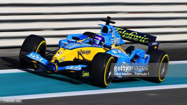 Fernando Alonso of Spain and Renault Sport F1 drives his 2005 F1 title winning Renault R25 on track before the F1 Grand Prix of Abu Dhabi at Yas...