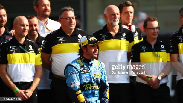Fernando Alonso of Spain and Renault Sport F1 poses for a photo with his 2005 F1 title winning Renault R25 and members of the Renault team from the...