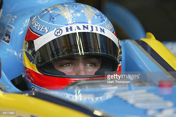Fernando Alonso of Spain and Renault waits for his turn during qualifying session for the Formula One Hungarian Grand Prix at the Hungaroring on...