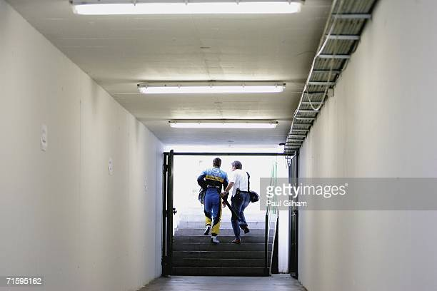 Fernando Alonso of Spain and Renault walks back to the paddock alongside a journalist after retiring from the race in the Hungarian Formula One Grand...