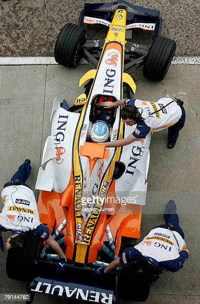 Fernando Alonso of Spain and team Renault is pushed back into the teams garage in the new R28 Renault Formula one car at the Ricardo Tormo racetrack...