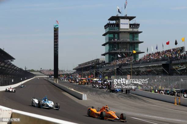 Fernando Alonso of Spain driver of the Chandon Honda drives during Carb day for the 101st Indianapolis 500 at Indianapolis Motorspeedway on May 26...