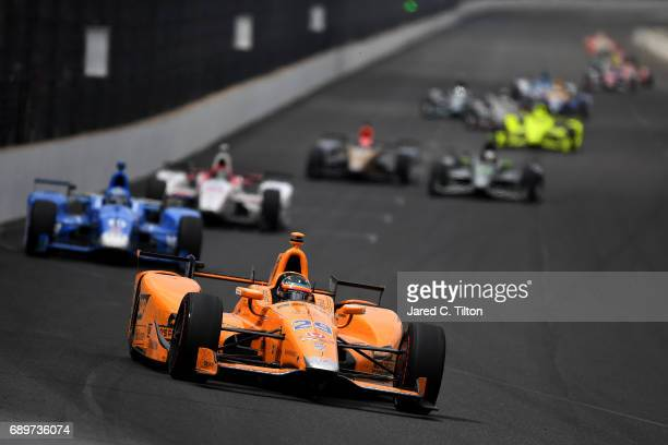 Fernando Alonso of Spain driver of the McLarenHondaAndretti Honda leads a pack of cars during the 101st Indianapolis 500 at Indianapolis...