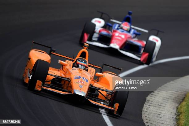 Fernando Alonso of Spain driver of the McLarenHondaAndretti Honda leads Carlos Munoz of Colombia driver of the ABC Supply AJ Foyt Racing Chevrolet...