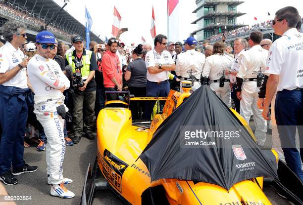 Fernando Alonso of Spain driver of the McLarenHondaAndretti Honda waits to get in his car ahead of the 101st running of the Indianapolis 500 at...
